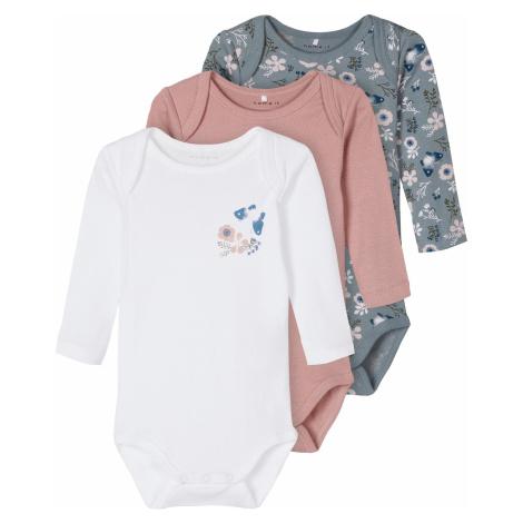 Weiβe bekleidung für babys